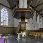 Interieur met houtsnijwerk (foto Stadsherstel)