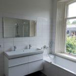 De gemoderniseerde Badkamer.