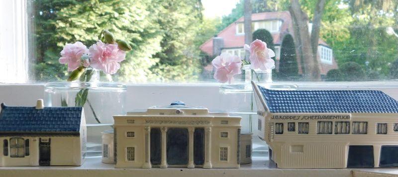 Blauw met witte miniatuur van de Haarlemmerpoort