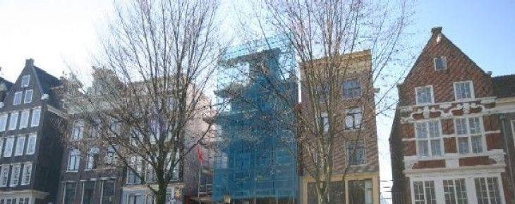 Restauratie en nieuwbouw op Oudezijds Voorburgwal 32-34 is begonnen